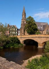 Image shows Telford Bridge in Morpeth on a suny day.