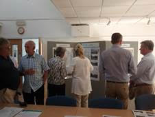 People looking information boards at the Roseland consultation