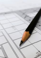 A pencil on top of building plans