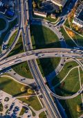 An aerial view of a roundabout with lots of other roads linking into it.